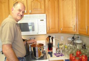 Trent Rasmussen stirs his homemade salsa.