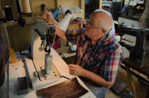 Don Roundy preping a sewing machine for work on a new boot.