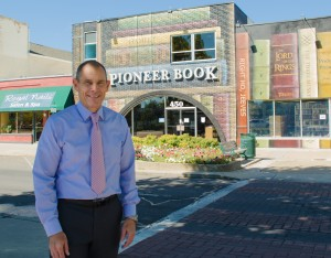 Provo Mayor John R. Curtis stands in front of the revitalized Pioneer Book