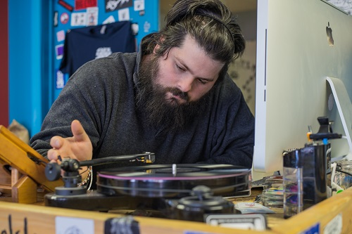 Adam Tye Cues up a record at his Shop on Edison. version 2