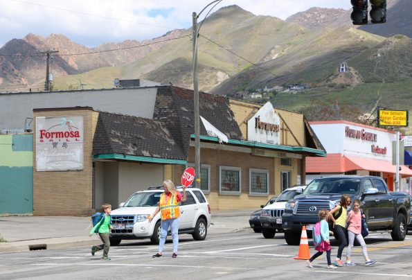 kids crossing at 2100 South and 2100 East abaondoned buildings