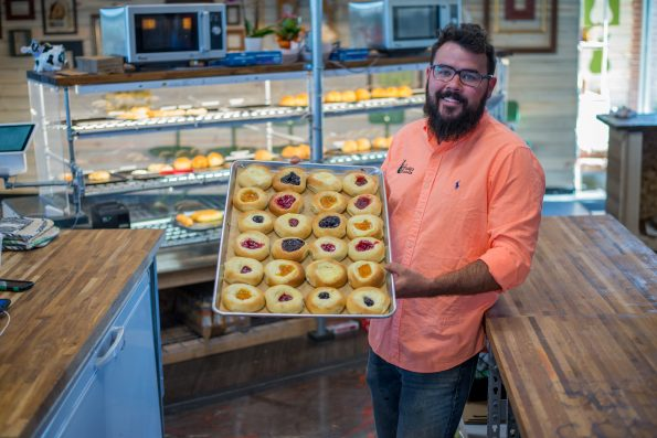 Ross Hruska Holds a baking sheet of traditional fruit Kolaches-1