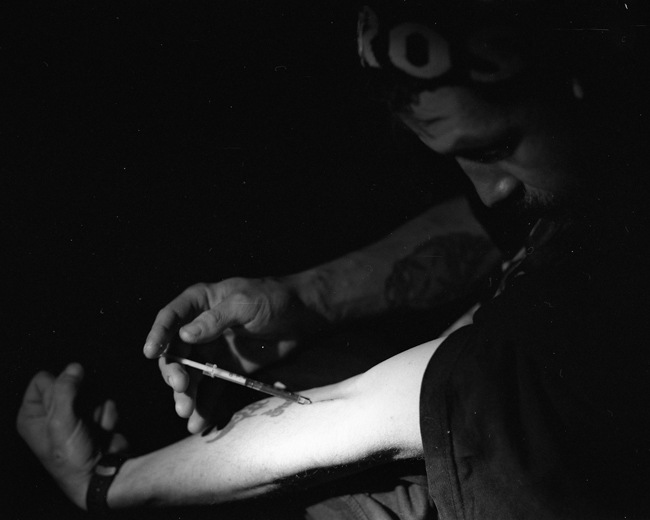 man injecting heroin