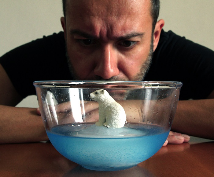 model of a polar bear on melting iceberg