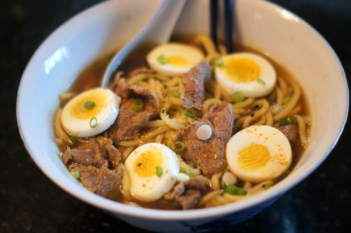While some ramen restaurants cook their broth for 24 hours or longer, this is an easy, shortcut recipe that makes pretty darned good ramen, if I do say so myself.