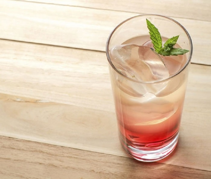 During the summertime, when it's hot out, enjoy a refreshing, light cocktail like this one: a classic French drink called the Vermouth Cassis.