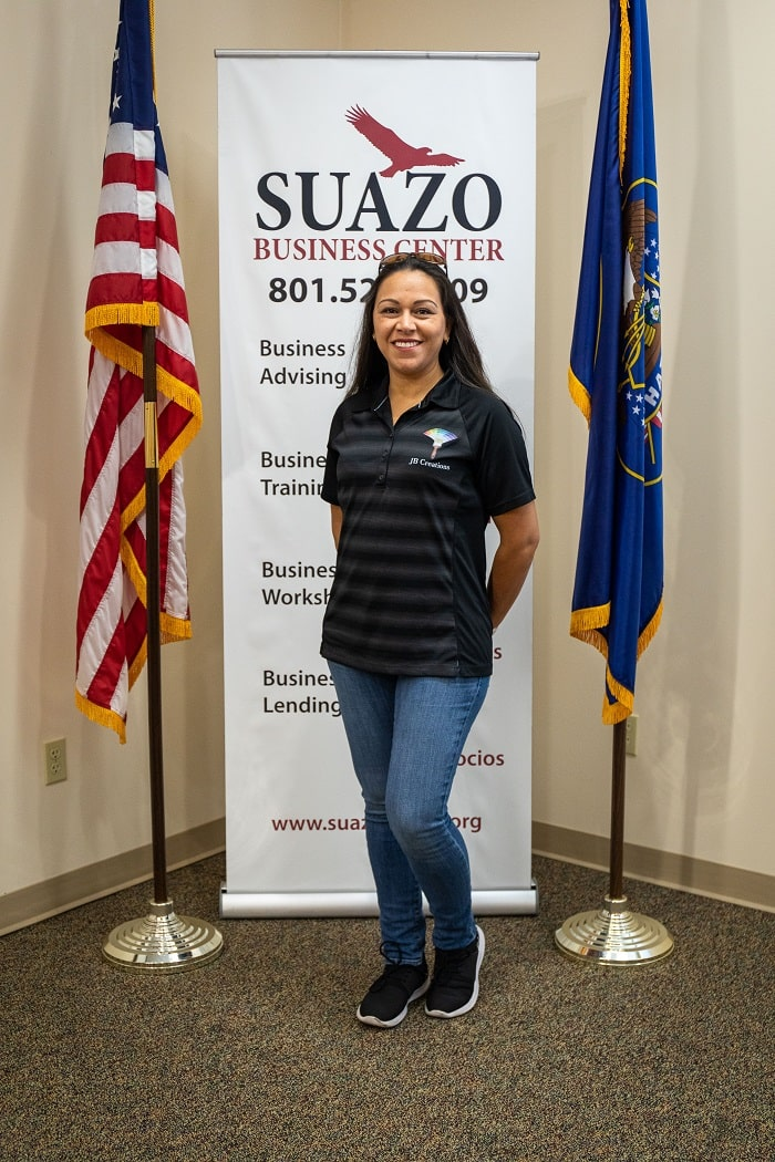 Marcela Lopez in front of the Suazo Business Center sign