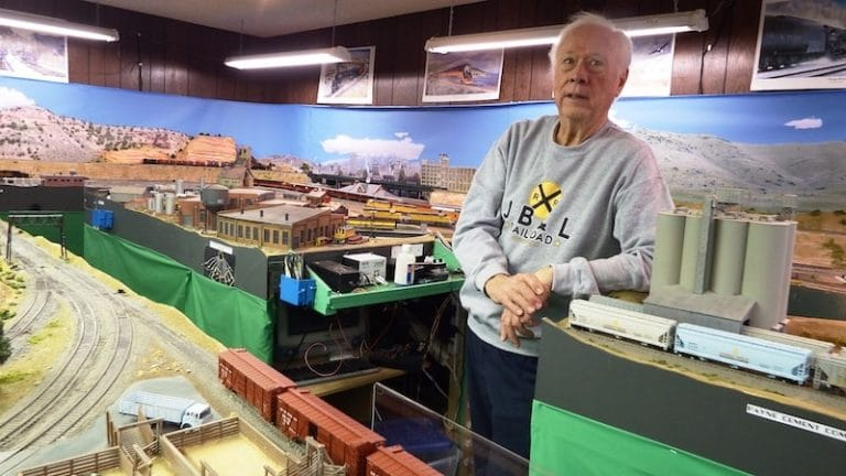 Lee Witten with his model trains setup. Photo by David E. Jensen.
