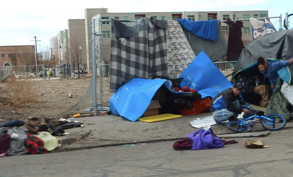 A homeless tent camp on a sidewalk in downtown Salt Lake City